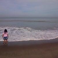 Photo taken at Pantai Cermin by Tasya P. on 8/13/2013