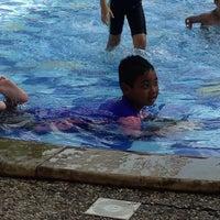 Photo taken at Swimming pool - Mercure Hotel by Iyan ResQ on 5/4/2014
