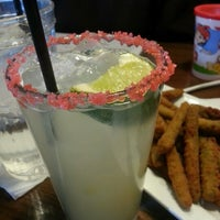 Photo taken at TGI Fridays by Lin W. on 12/29/2012