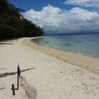 Photo taken at Manukan Island by Nicholas L. on 10/26/2012