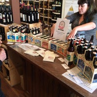 Photo taken at North Loop Wine & Spirits by Ken T. on 8/25/2015
