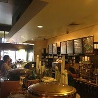 Photo taken at Starbucks by Uldis L. on 3/14/2013