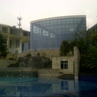 Photo taken at Lutang Hot Spring Resort by Jens T. on 9/12/2013