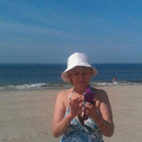 Photo taken at Plumb Beach by Volodymyr S. on 6/9/2013