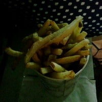 Photo taken at Thrasher's French Fries by Elliot on 9/22/2012