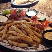 Photo taken at Paymon's Mediterranean Cafe & Hookah Lounge by Staci on 7/1/2013