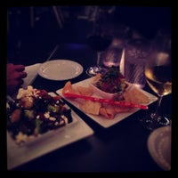 Photo taken at The Grove Wine Bar & Kitchen - West Lake by Juhee W. on 12/9/2012