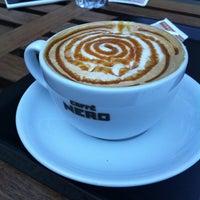 Photo taken at Caffé Nero by Damla on 12/3/2012