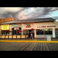 Photo taken at Rusty's Surf Ranch by 〽️iguel Q. on 10/6/2012