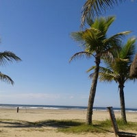 Photo taken at Praia do Sesc Bertioga by Caah R. on 3/17/2014