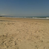 Photo taken at Praia de Itapema do Norte by Marina K. on 11/4/2012