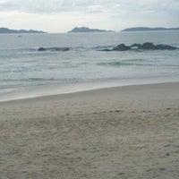 Photo taken at Praia de Samil by Rui B. on 10/25/2012