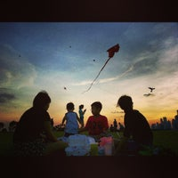 Photo taken at Marina Barrage by Moses A. on 3/16/2013
