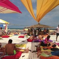 Photo taken at Suma Beach by Mert K. on 8/11/2013