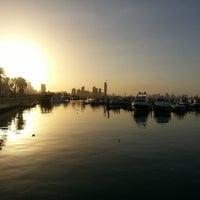 Photo taken at Marina Beach by Ayman A. on 2/1/2013
