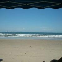 Photo taken at Praia de Itapoá by Tatiane M. on 1/28/2013