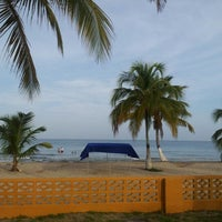 Photo taken at Coveñas by Oscar R. on 11/4/2012