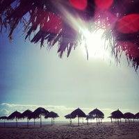 Photo taken at Playa Pelúa by María Laura C. on 7/4/2013