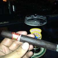 Photo taken at Stanley's Cigar Lounge by Nick F. on 12/5/2012