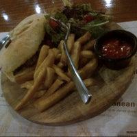 Photo taken at MUNCHIES Restaurant & Bar by Keyvi K. on 12/20/2012