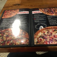 Photo taken at Hideaway Pizza by Neil S. on 3/5/2018