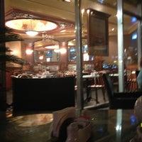Photo taken at Dôme Café by Игорь С. on 12/10/2012