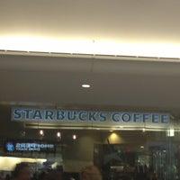 Photo taken at Starbucks by Alina D. on 6/19/2013