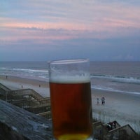 Photo taken at Surf City Beach by Jared B. on 7/7/2014