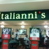 Photo taken at Italianni's Pasta, Pizza & Vino by Sergio V. on 2/24/2013