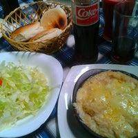 Photo taken at Restaurant Las Conchitas by Fernanda G. on 1/27/2013