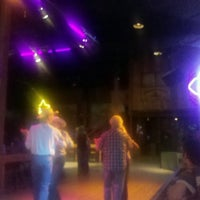 Photo taken at Stampede Mesquite Grill & Dance Emporium by Kat H. on 5/29/2014