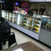 Photo taken at Colonial Donuts by Lamont P. on 3/8/2013