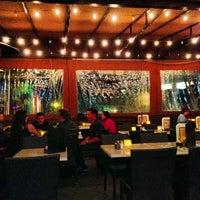 Photo taken at Bossa Nova Brazilian Cuisine by LA Social F. on 10/23/2012