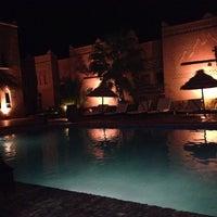 Photo taken at Kasbah Tizimi Hotel Erfoud by Martina R. on 10/28/2013