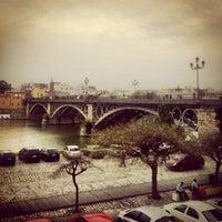 Photo taken at Isabel II Bridge 'Triana Bridge' by VictoRoldan on 3/30/2013