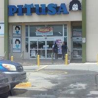Photo taken at Pitusa by Jose P. on 7/3/2013