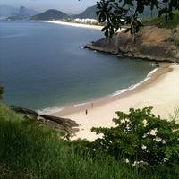 Photo taken at Praia do Sossego by Thiago L. on 2/26/2013