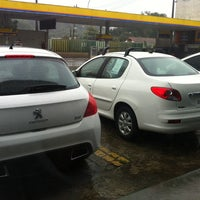 Photo taken at Peugeot LA VILLETTE (Volta Redonda) by Camila M. on 7/25/2013