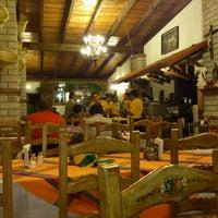 Photo taken at Rincón Del Puga by Juan Carlos M. on 3/19/2013