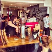 Photo taken at Nude Espresso by Simon T. on 4/21/2013
