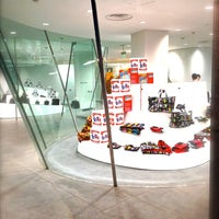 Photo taken at COMME des GARÇONS 青山店 by fulxus on 5/2/2013
