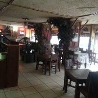 Photo taken at Cafe Emirgan by Kutay T. on 2/4/2013