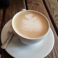 Photo taken at Cafe Emirgan by Kutay T. on 8/9/2014