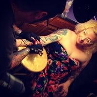 Photo taken at Gary's Tattoo Studio by Catherine K. on 7/19/2013