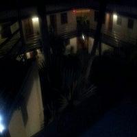 Photo taken at El Patio Motel Roof Deck by Matthew B. on 9/21/2012