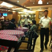Photo taken at Bella Italia, Dhanmondi by K. K. B. on 10/20/2012