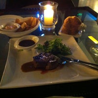 Photo taken at Flamme The Ultimate Steak by Krzysztof J. on 5/13/2013