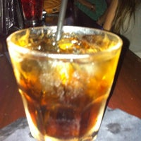 Photo taken at Mom's Bar & Lounge by Jenny G. on 9/29/2012