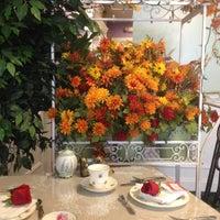Photo taken at The Secret Garden Tea Cafe & Gift Shoppe by Georgie C. on 11/21/2012
