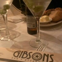 Photo taken at Gibsons Bar & Steakhouse by Lucas V. on 3/4/2013